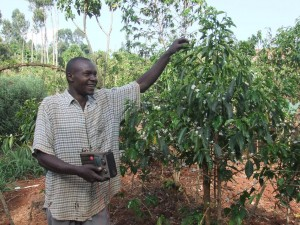 Farmer Mutonyi form Rumukia with his radio which he listens for coffee programs